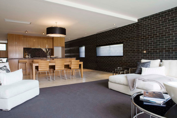 living room and dining room design ideas with black brick wall tiles